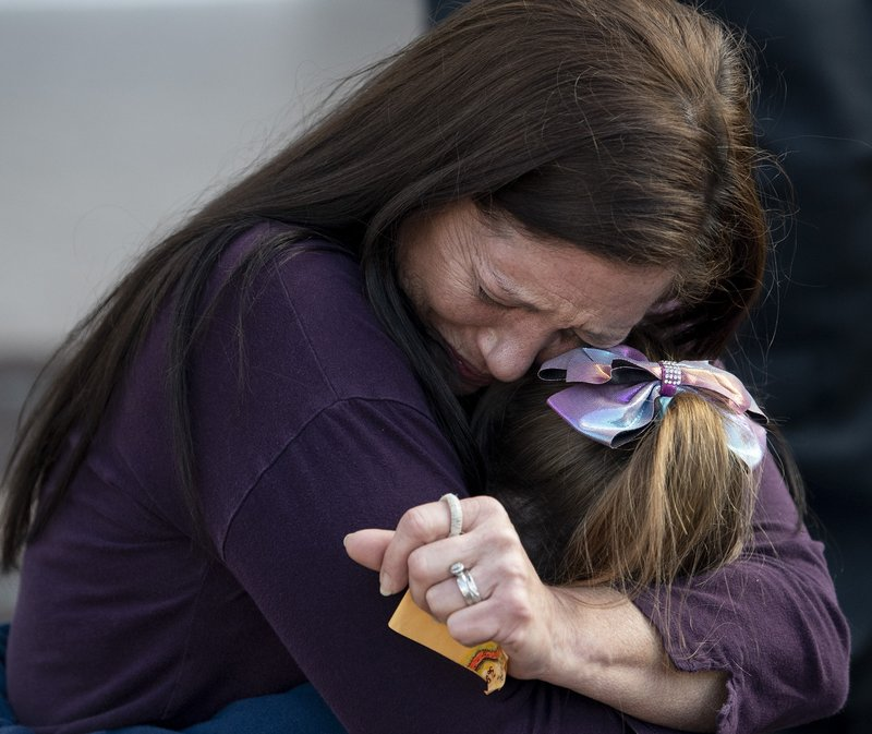 Jerri Ford, whose husband Paul Ford committed suicide in prison, hugs her daughter Laylah Littlefield as the Southern Poverty Law Center holds a press conference to update the status of their lawsuit against the Alabama Department of Corrections, dealing with the medical and mental health needs of inmates, on the steps of the Alabama Statehouse in Montgomery, Ala. (Mickey Welsh/The Montgomery Advertiser via AP)