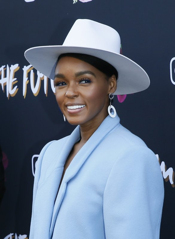 Janelle Monae poses at the