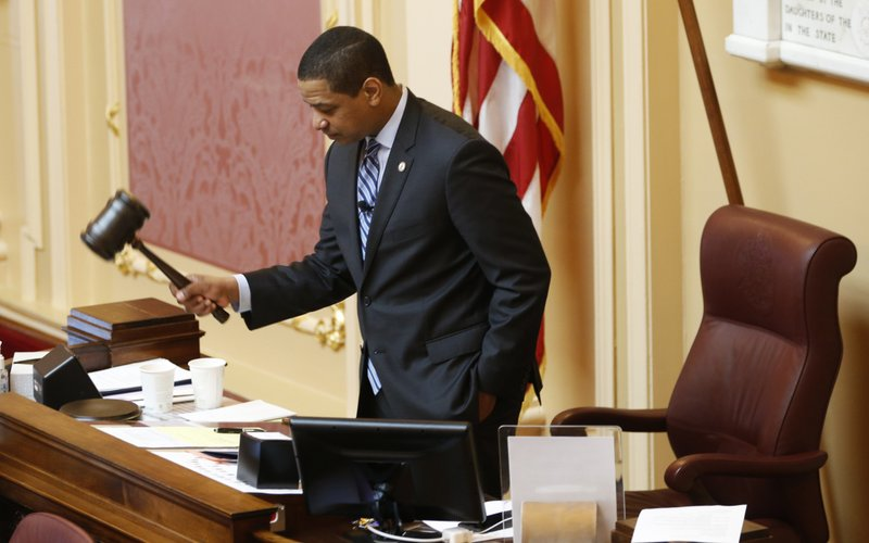 Virginia Lt. Gov. Justin Fairfax, gavels the session to order at the start of the Senate session at the Capitol in Richmond, Va. (AP Photo/Steve Helber)
