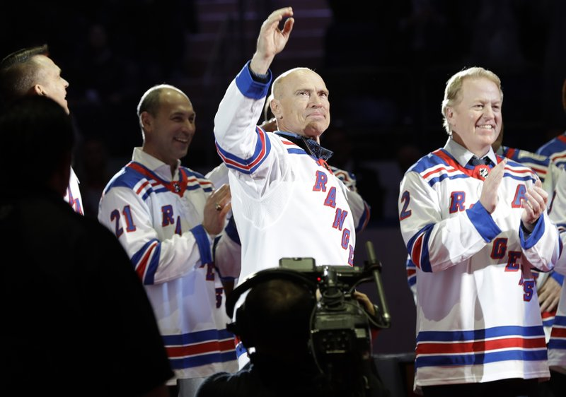 Mark Messier waves to fans, during an event to honor the 25th anniversary of the 1994 New York Rangers winning the Stanley Cup, before an NHL hockey game between the Rangers and the Carolina Hurricanes on Friday, Feb. (AP Photo/Frank Franklin II)