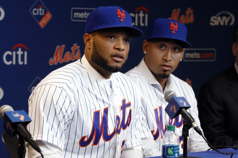 FILE - In this Dec. 4, 2018, file photo, Robinson Cano, left, and Edwin Diaz participate in a news conference at CitiField, in New York. (AP Photo/Richard Drew, File)