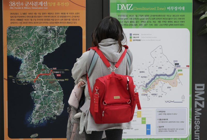 A visitor looks at a map of the Korean peninsula at the DMZ museum inside a restricted area in Goseong, South Korea, Friday, Feb. (AP Photo/Lee Jin-man)