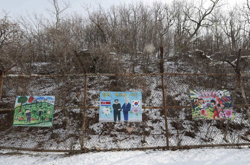 Paintings wishing peace on the Korean peninsula hang on a fence at the DMZ museum inside a restricted area in Goseong, South Korea, Friday, Feb. (AP Photo/Lee Jin-man)