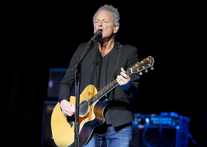 FILE - In this Dec. 5, 2018 file photo, Lindsey Buckingham performs at The Wilbur Theatre in Boston. Buckingham underwent open heart surgery that left the former Fleetwood Mac guitarist with damaged vocal cords. (Photo by Winslow Townson/Invision/AP)