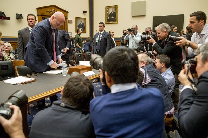 Acting Attorney General Matthew Whitaker stands to leave a House Judiciary Committee hearing during a recess on Capitol Hill, Friday, Feb. (AP Photo/Andrew Harnik)