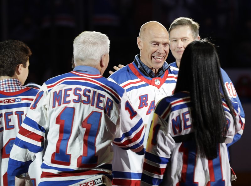 Mark Messier greets fans as the 1994 New York Rangers are honored for winning the Stanley Cup, before an NHL hockey game between the Rangers and the Carolina Hurricanes on Friday, Feb. (AP Photo/Frank Franklin II)