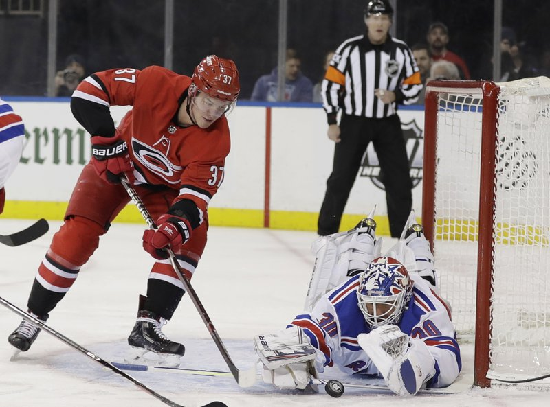 New York Rangers goaltender Henrik Lundqvist (30) stops a shot by Carolina Hurricanes' Andrei Svechnikov (37) during the first period of an NHL hockey game Friday, Feb. (AP Photo/Frank Franklin II)