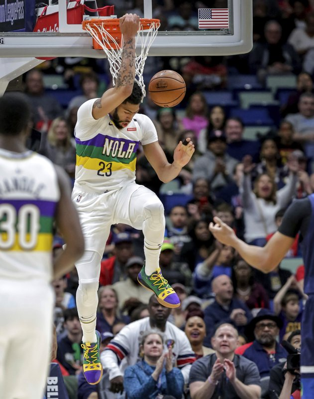 New Orleans Pelicans forward Anthony Davis (23) dunks against the Minnesota Timberwolves in the first half of an NBA basketball game in New Orleans, Friday, Feb. (AP Photo/Scott Threlkeld)