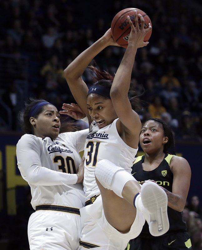 California's Kristine Anigwe rebounds between teammate CJ West (30) and Oregon's Oti Gildon, right, during the first half of an NCAA college basketball game Friday, Feb. (AP Photo/Ben Margot)