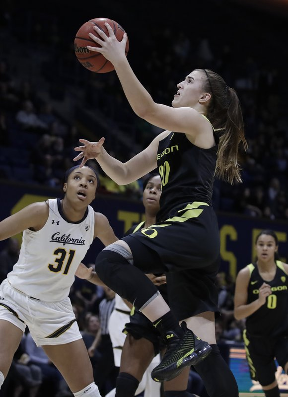 Oregon's Sabrina Ionescu, right, lays up a shot past California's Kristine Anigwe (31) during the first half of an NCAA college basketball game Friday, Feb. (AP Photo/Ben Margot)