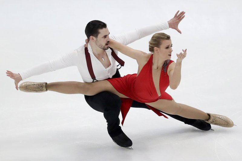 Madison Hubbell and Zachary Donohue, of the United States, perform during the ice dance rhythm dance competition at the Four Continents Figure Skating Championships on Friday, Feb. (AP Photo/Chris Carlson)