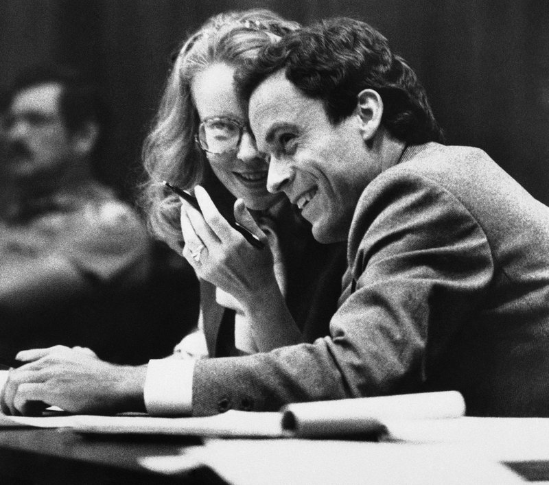 FILE - In this July 6, 1979 file photo, Ted Bundy, right, confers with Margaret Good, a member of his defense team, during jury selection for Bundy's murder trial in Miami, Fla. (AP Photo/Pool)