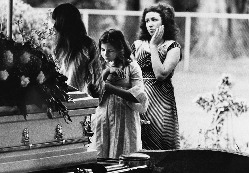 FILE - In this April 13, 1978 file photo, mourners say goodbye to Kimberly Leach at the funeral for the 12-year-old girl in Lake City, Fla. (AP Photo)
