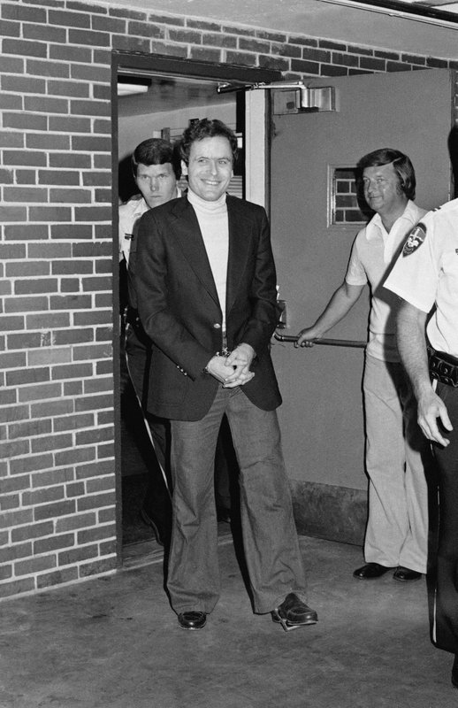 FILE - In this June 13, 1977 file photo, Ted Bundy appears in cuffs after being recaptured just outside of Aspen City limits. (AP Photo)
