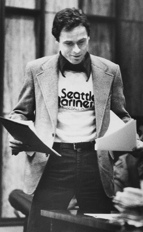 FILE - In this July 5, 1979 file photo, accused serial killer Ted Bundy wears a Seattle Mariners T-shirt in court in Miami, as he presents is own motions and made a request for a typewriter in his Dade County jail cell. (AP Photo)