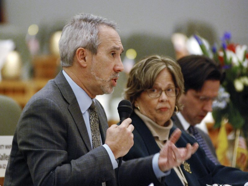 In this Monday, Feb. 4, 2019, photo, Democratic state Rep. Daymon Ely of Corrales, N.M., left, explains provisions of a bill he sponsored with Rep. (AP Photo/Morgan Lee)