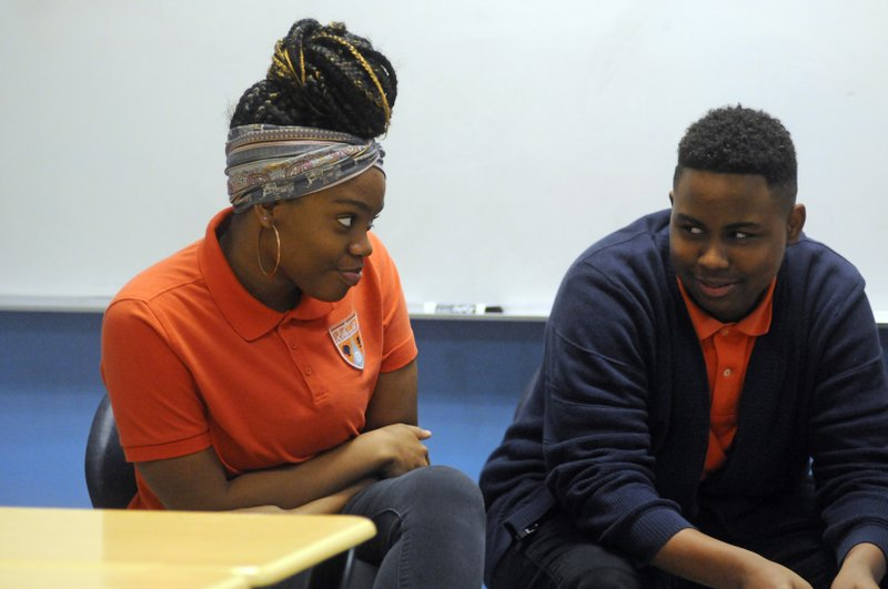 In this Nov. 15, 2018 photo, students participate in a Youth Aware of Mental Health session at Uplift Hampton Preparatory School in Dallas. (AP Photo/Benny Snyder)
