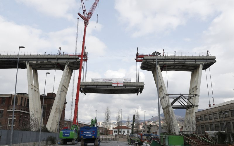 A view of of the Morandi bridge in Genoa, Italy, Saturday, Feb. 9, 2019. Workers taking apart the remains of a bridge which collapsed in Aug. (AP Photo/Antonio Calanni)