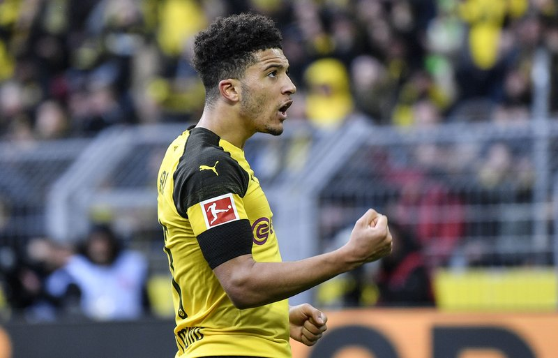 Dortmund's Jadon Sancho reacts after he scored the opening goal during the German Bundesliga soccer match between Borussia Dortmund and TSG 1899 Hoffenheim in Dortmund, Germany, Saturday, Feb. (AP Photo/Martin Meissner)