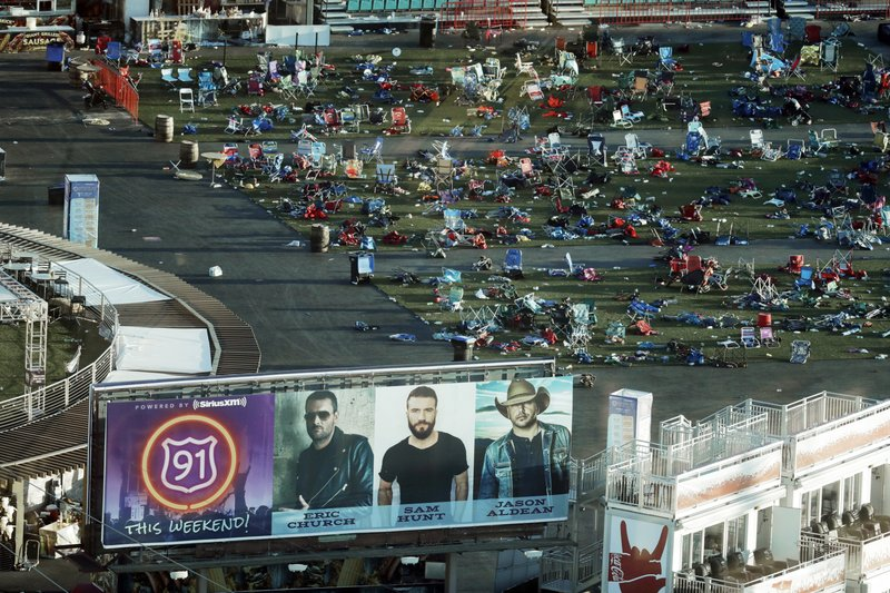 FILE - In this Oct. 3, 2017 file photo, personal belongings and debris litters the Route 91 Harvest festival grounds across the street from the Mandalay Bay resort and casino after an Oct. (AP Photo/Marcio Jose Sanchez, File)