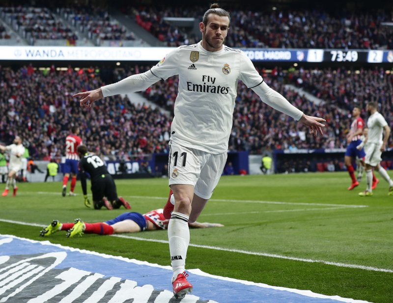 Real Madrid's Gareth Bale celebrates after scoring his side's 3rd goal during a Spanish La Liga soccer match between Atletico Madrid and Real Madrid at the Metropolitano stadium in Madrid, Spain, Saturday, Feb. (AP Photo/Manu Fernandez)
