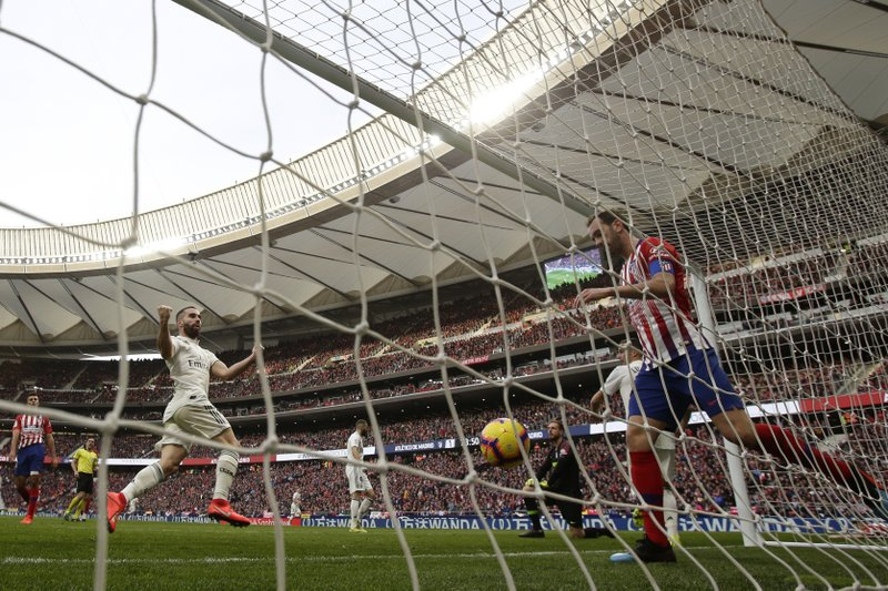 Real Madrid's Dani Carvajal celebrates after Gareth Bale scored his side's 3rd goal during a Spanish La Liga soccer match between Atletico Madrid and Real Madrid at the Metropolitano stadium in Madrid, Spain, Saturday, Feb. (AP Photo/Manu Fernandez)