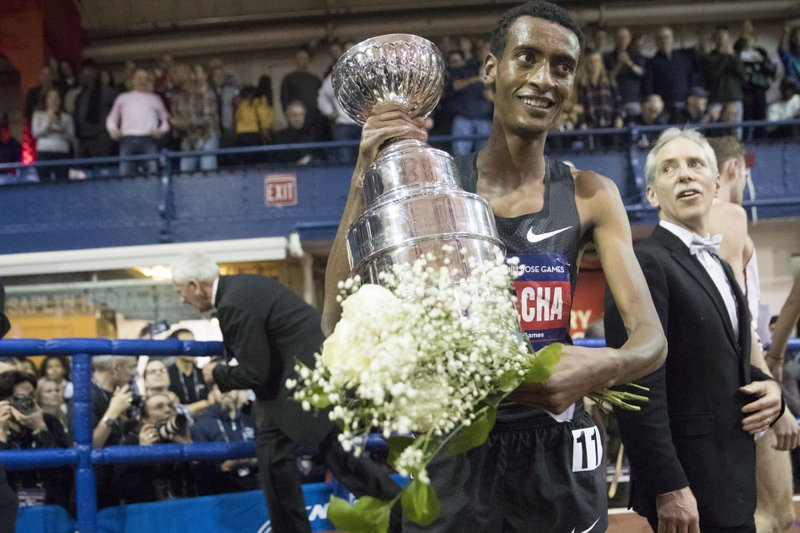 Yomif Kejelcha, of Ethiopia holds his trophy after winning the men's Wanamaker Mile at the Millrose Games track and field meet, Saturday, Feb. (AP Photo/Mary Altaffer)