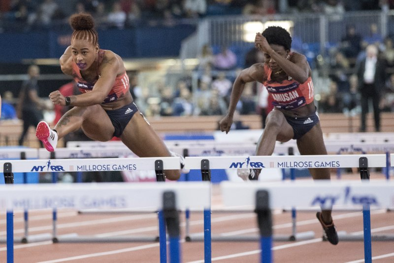 Sharika Nelvis, left, competes in the women's 60-meter hurdles at the Millrose Games track and field meet, Saturday, Feb. (AP Photo/Mary Altaffer)
