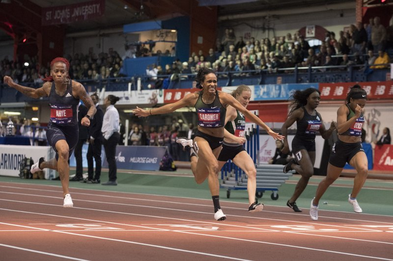 English Gardner crosses the finish line in the women's 60-meter sprint at the Millrose Games track and field meet, Saturday, Feb. (AP Photo/Mary Altaffer)