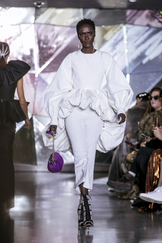 The latest fashion creation from Christian Siriano is modeled during New York Fashion Week, Saturday, Feb. (AP Photo/Kevin Hagen)