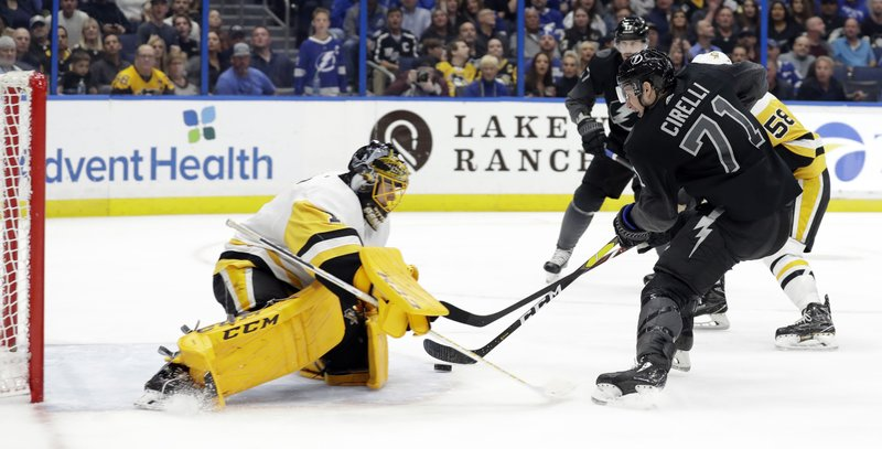 Tampa Bay Lightning center Anthony Cirelli (71) beats Pittsburgh Penguins goaltender Casey DeSmith (1) for a goal during the second period of an NHL hockey game Saturday, Feb. (AP Photo/Chris O'Meara)