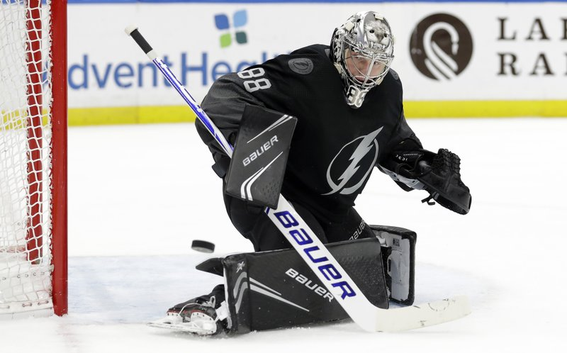 Tampa Bay Lightning goaltender Andrei Vasilevskiy (88) makes a save on a shot by the Pittsburgh Penguins during the first period of an NHL hockey game Saturday, Feb. (AP Photo/Chris O'Meara)
