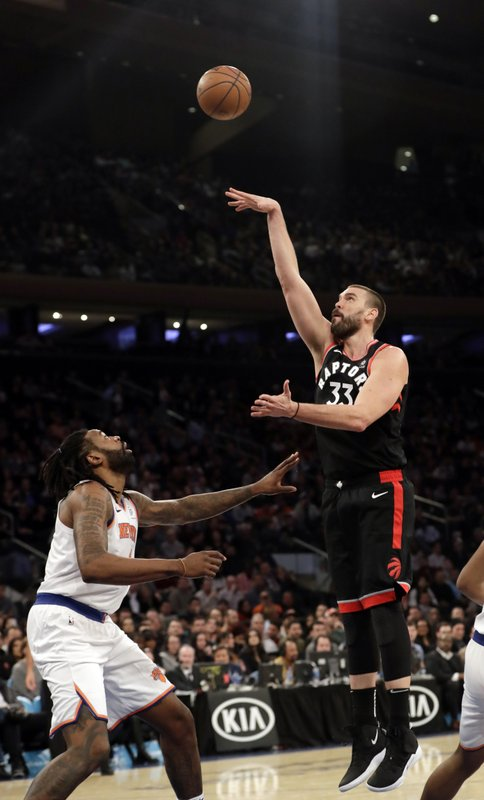 Toronto Raptors' Marc Gasol, right, shoots over New York Knicks' DeAndre Jordan during the first half of an NBA basketball game, Saturday, Feb. (AP Photo/Frank Franklin II)