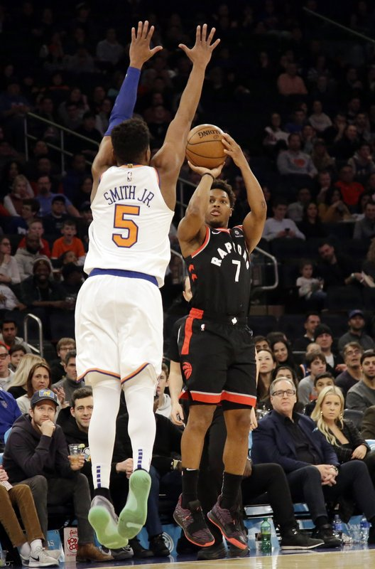 Toronto Raptors' Kyle Lowry (7) shoots over New York Knicks' Dennis Smith Jr. (5) during the first half of an NBA basketball game, Saturday, Feb. (AP Photo/Frank Franklin II)