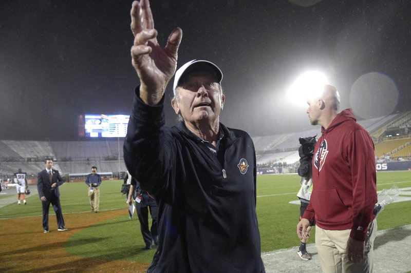 Orlando Apollos coach Steve Spurrier acknowledges fans in the stands after the team's Alliance of American Football game against the Atlanta Legends on Saturday, Feb. (AP Photo/Phelan M. Ebenhack)