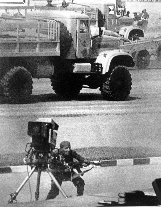FILE - In this Oct. 6, 1981 file photo, a gunman, wearing an Egyptian army uniform, fires an automatic Kalashnikov rifle into the reviewing stand during an attack that took the life of President Anwar Sadat and five others in Cairo, Egypt. (AP Photo, File)