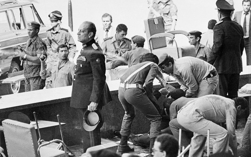 FILE - In this Oct. 6, 1981 file photograph, Egyptian soldiers tend to wounded after an attack on the reviewing platform which killed Egyptian President Anwar Sadat in Cairo, Egypt. (AP Photo, File)