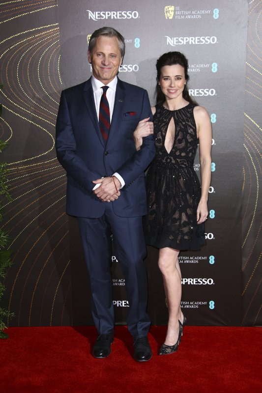 Actors Viggo Mortensen, left, and Linda Cardellini pose for photographers upon arrival at the BAFTA Nominees Party in London, Saturday, Feb. (Photo by Joel C Ryan/Invision/AP)