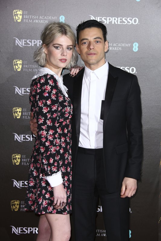 Actors Lucy Boynton, left, and Rami Malek pose for photographers upon arrival at the BAFTA Nominees Party in London, Saturday, Feb. (Photo by Joel C Ryan/Invision/AP)