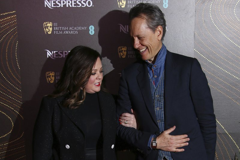 Actors Melissa McCarthy, left, and Richard E. Grant pose for photographers upon arrival at the BAFTA Nominees Party in London, Saturday, Feb. (Photo by Joel C Ryan/Invision/AP)