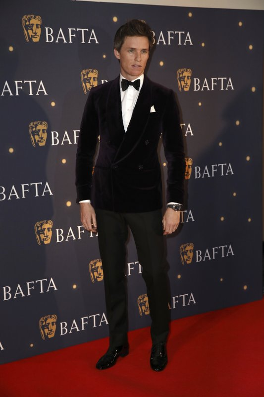 Actor Eddie Redmayne poses for photographers on arrival at a BAFTA Fundraising Gala in London, Friday, Feb. (Photo by Grant Pollard/Invision/AP)