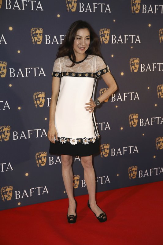 Actress Michelle Yeoh poses for photographers on arrival at a BAFTA Fundraising Gala in London, Friday, Feb. (Photo by Grant Pollard/Invision/AP)