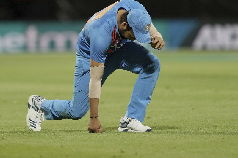 India's Rohit Sharma reacts after dropping a catch during their twenty/20 cricket international against New Zealand at Seddon Park in Auckland, New Zealand, Sunday, Feb. (AP Photo/David Rowland)