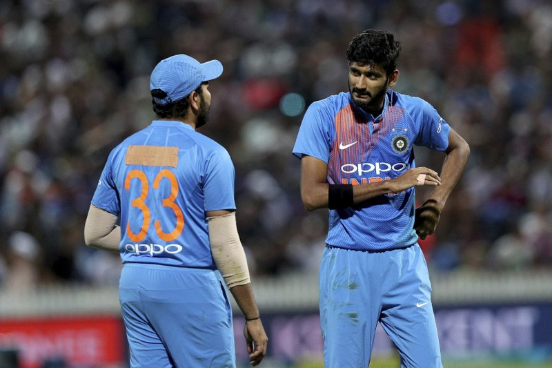 India's Rohit Sharma, left, speaks with Kahleel Ahmed as he bowls during their twenty/20 cricket international against New Zealand at Seddon Park in Auckland, New Zealand, Sunday, Feb. (AP Photo/David Rowland)