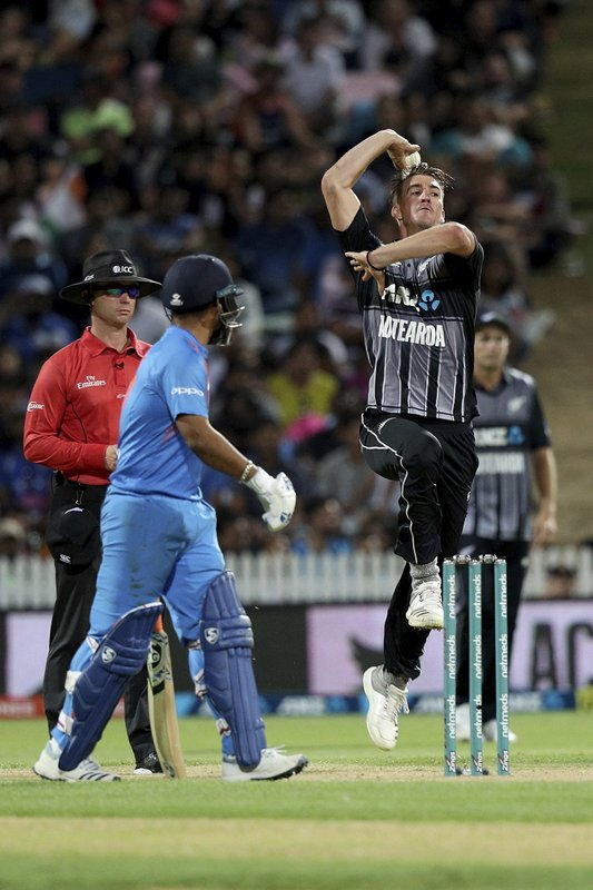 New Zealand's Blair Tickner bowls during their twenty/20 cricket international against India at Seddon Park in Auckland, New Zealand, Sunday, Feb. (AP Photo/David Rowland)