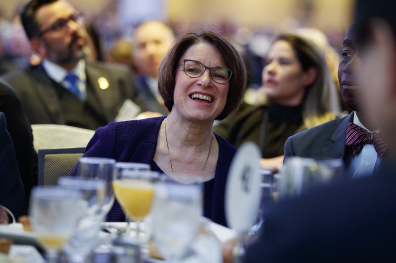 Sen. Amy Klobuchar, D-Minn., listens during the National Prayer Breakfast, Thursday, Feb. 7, 2019, in Washington. (AP Photo/ Evan Vucci)