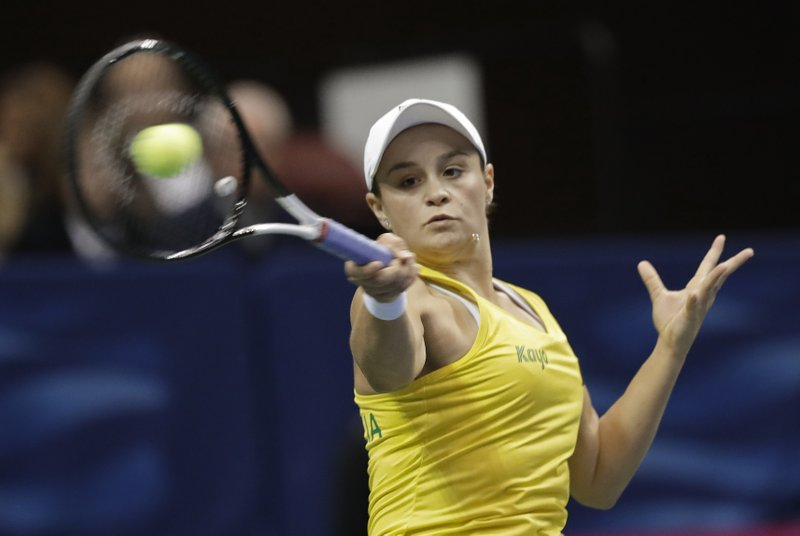Australia's Ashleigh Barty returns a shot against United State's Sofia Kenin in their first-round Fed Cup tennis match in Asheville, N. (AP Photo/Chuck Burton)