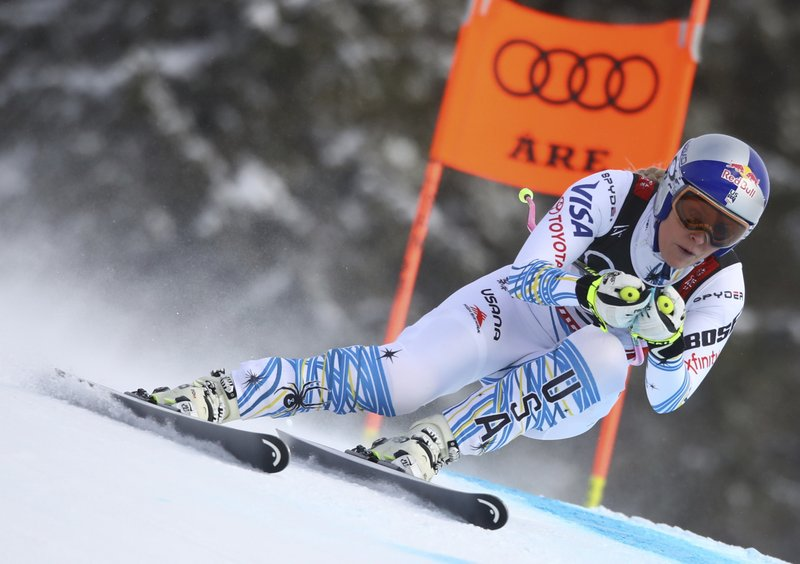 Lindsey Vonn speeds down the course during the women's downhill race, at the alpine ski World Championships in Are, Sweden, Sunday, Feb. (AP Photo/Alessandro Trovati)