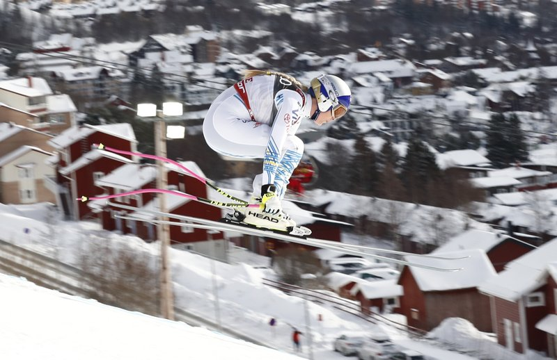 Lindsey Vonn speeds down the course during the women's downhill race, at the alpine ski World Championships in Are, Sweden, Sunday, Feb. (AP Photo/Gabriele Facciotti)
