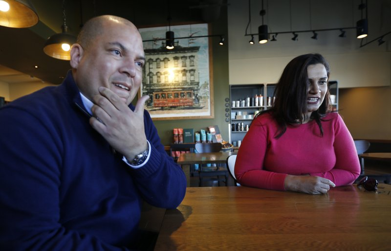 In this Jan. 10, 2019, photo David Harris Jr., left, the nephew of Arthur Ashe, and Richmond City Council member, Kim Gray, right, gesture during an interview in Richmond, Va. (AP Photo/Steve Helber)